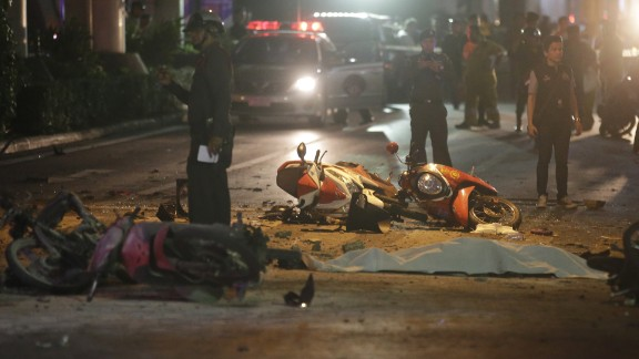 Motorcycles and debris lies on the pavement after an explosion in Bangkok, Monday, Aug. 17, 2015. A large explosion rocked a central Bangkok intersection during the evening rush hour, killing a number of people and injuring others, police said. (AP Photo/Sackchai Lalit)