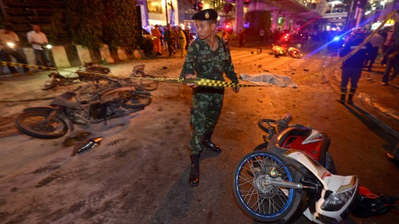 A Thai soldier ropes off the scene of the bombing.