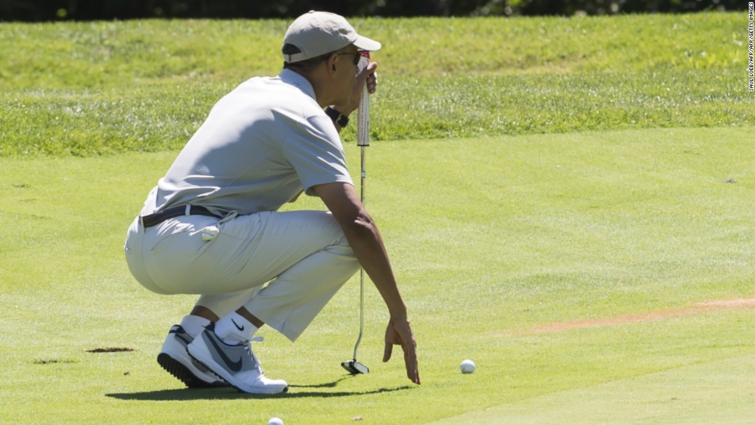 Obama lines up a putt as he plays golf on August 8.