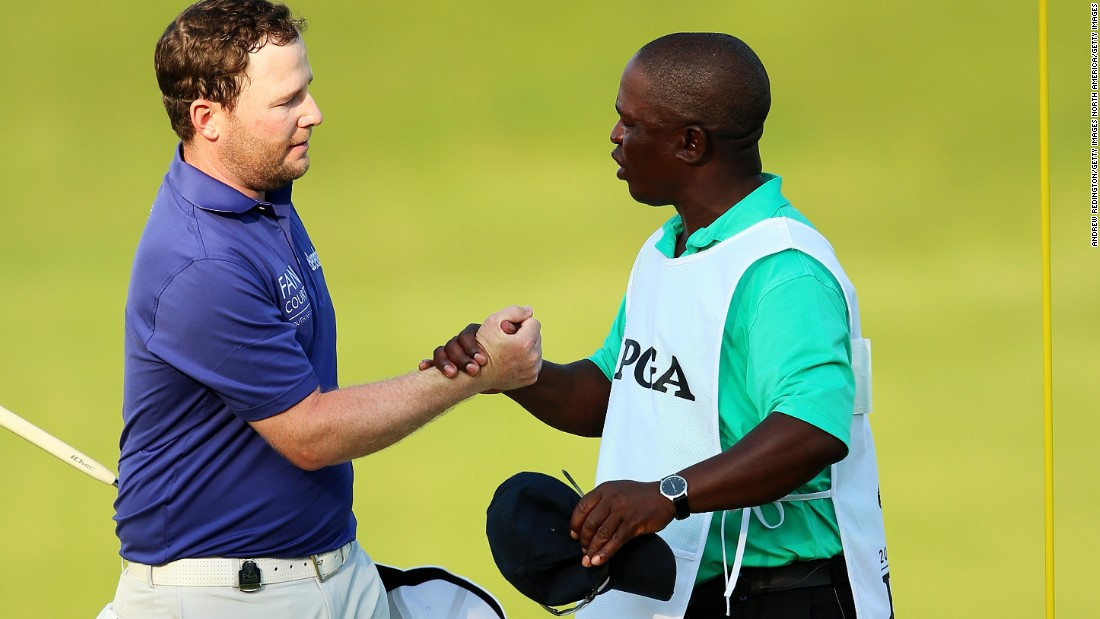 South Africa's Branden Grace celebrates with his caddy Zac Rasego after finishing third on 15 under -- his best result in a major, having tied for fourth at this year's U.S. Open.