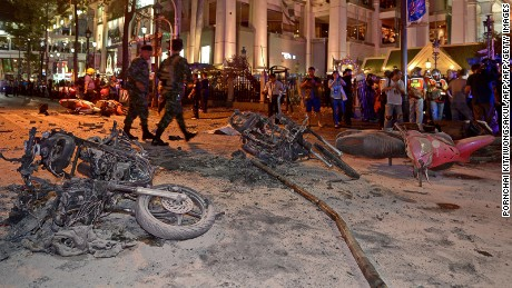 Thai soldiers inspect the scene after a bomb exploded outside a religious shrine in central Bangkok late on August 17, 2015 killing at least 10 people and wounding scores more.
