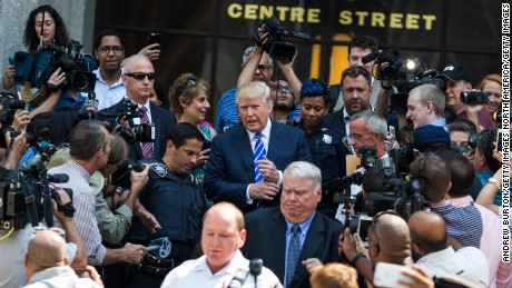NEW YORK, NY - AUGUST 17:  Republican Presidential hopeful Donald Trump leaves Manhattan Supreme Court where he is serving on jury duty on August 17, 2015 in New York City. Trump spent the last few days on the campaign trail at the Iowa state fair before returning to New York to perform the civic duty.  (Photo by Andrew Burton/Getty Images)