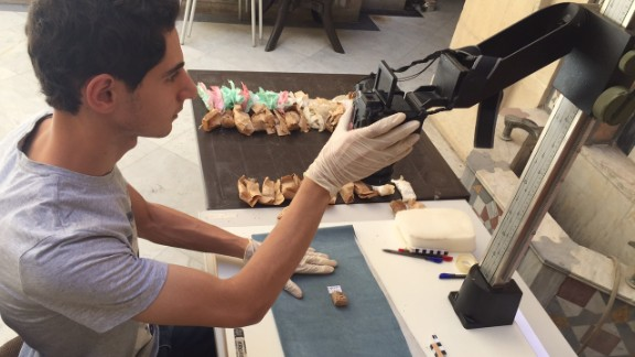 The team evacuated 35,000 artifacts from Deir Ezzor alone. Each one is photographed and given a catalog number.