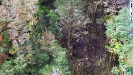 This handout aerial photo released by the National Search and Rescue Agency (Basarnas) on August 17, 2015 shows the wreckage from a Trigana Air ATR 42-300 twin-turboprop scattered amongst trees in the mountainous area of Oksibil district, in Papua province, a day after it went missing after take-off from Jayapura, the capital of Papua province. Rescuers raced on August 17 to reach debris in remote eastern Indonesian mountains believed to be from the plane that crashed carrying 54 people and cash worth almost half a million USD.