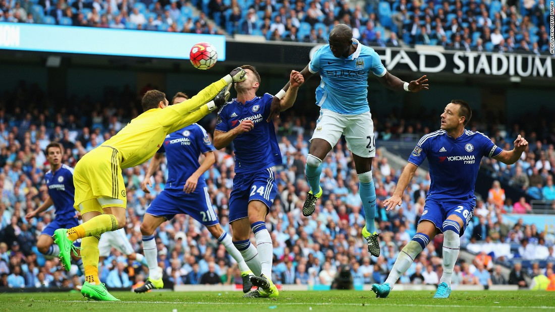 Chelsea goalkeeper Asmir Begovic tries to punch away the ball, but he connects with the face of teammate Gary Cahill instead during a Premier League match in Manchester, England, on Sunday, August 16. Chelsea, last season's Premier League champions, lost the match 3-0 to Manchester City.