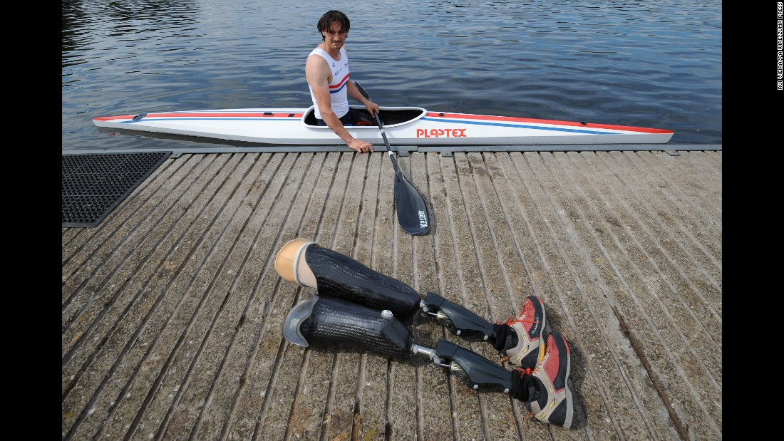 British rower Nick Beighton looks at his prosthetic legs Tuesday, August 11, while training in Nottingham, England, for the Paracanoe World Championships.