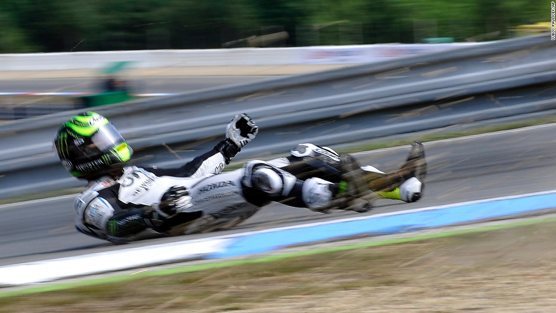 Cal Crutchlow falls off his motorcycle during the MotoGP race in Brno, Czech Republic, on Sunday, August 16. He was not seriously hurt.