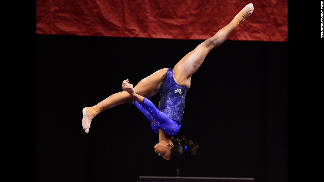 Gabby Douglas, an American gymnast who won Olympic gold in the 2012 all-around, competes on the balance beam during the P&G Gymnastics Championships on Thursday, August 13. The national competition was held in Indianapolis.
