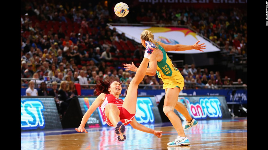 England's Jade Clarke falls after colliding with Australia's Laura Geitz during a Netball World Cup match in Sydney on Tuesday, August 11. Australia would go on to win the tournament, its 11th title. England finished in third place.