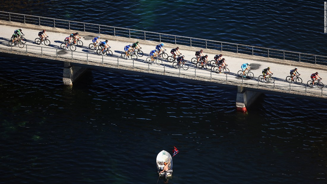 Cyclists compete in Malselv, Norway, during the third stage of the Arctic Race of Norway on Saturday, August 15.