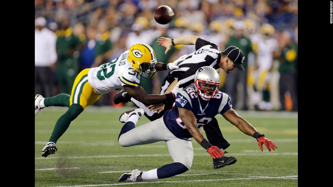 Green Bay Packers safety Chris Banjo breaks up a pass intended for New England Patriots wide receiver Josh Boyce during a preseason game in Foxborough, Massachusetts, on Thursday, August 13. Official Shawn Hochuli got tangled up in the play.