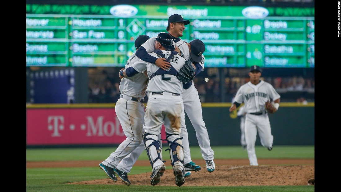 Seattle Mariners pitcher Hisashi Iwakuma is swarmed by teammates after he threw a no-hitter against Baltimore on Wednesday, August 12. Iwakuma is the second Japanese-born player to throw a no-hitter in the majors. Hideo Nomo threw two no-hitters during his career.