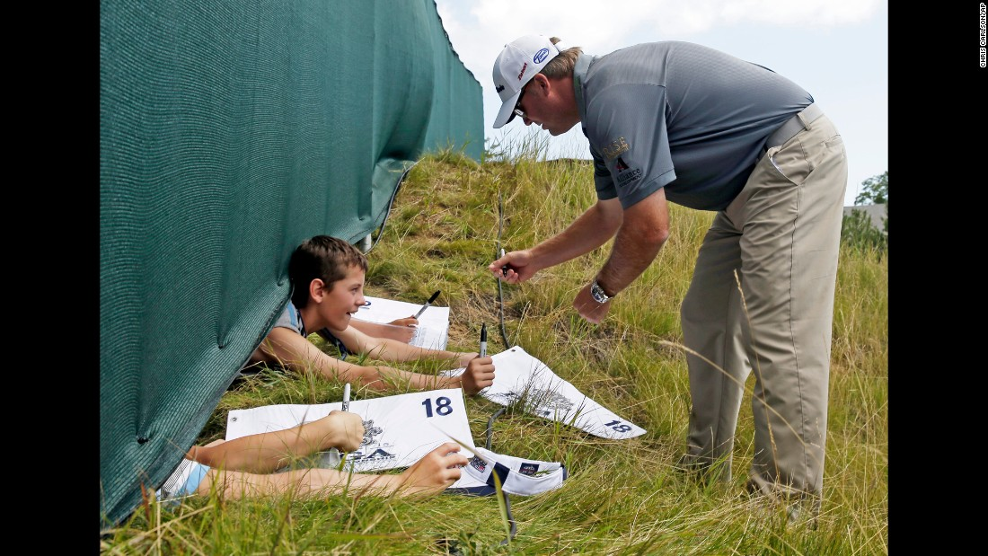 Ryan Helminen signs some autographs during a practice round at the PGA Championship on Wednesday, August 12.