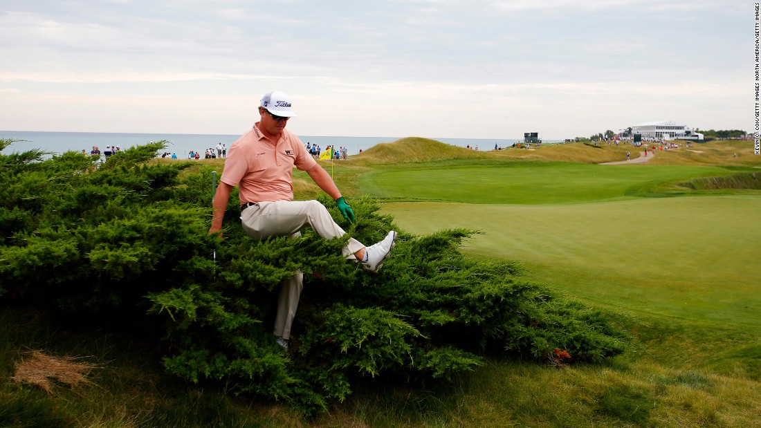 Charley Hoffman searches for his ball during the first round of the PGA Championship on Thursday, August 13. The major tournament was played at the Whistling Straits golf course in Sheboygan, Wisconsin.