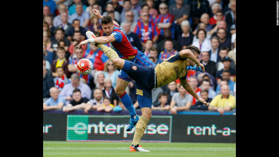 Arsenal's Olivier Giroud, front, vies for the ball with Crystal Palace's Joel Ward during a Premier League match in London on Sunday, August 16. Giroud scored a goal in the match as Arsenal won 2-1.