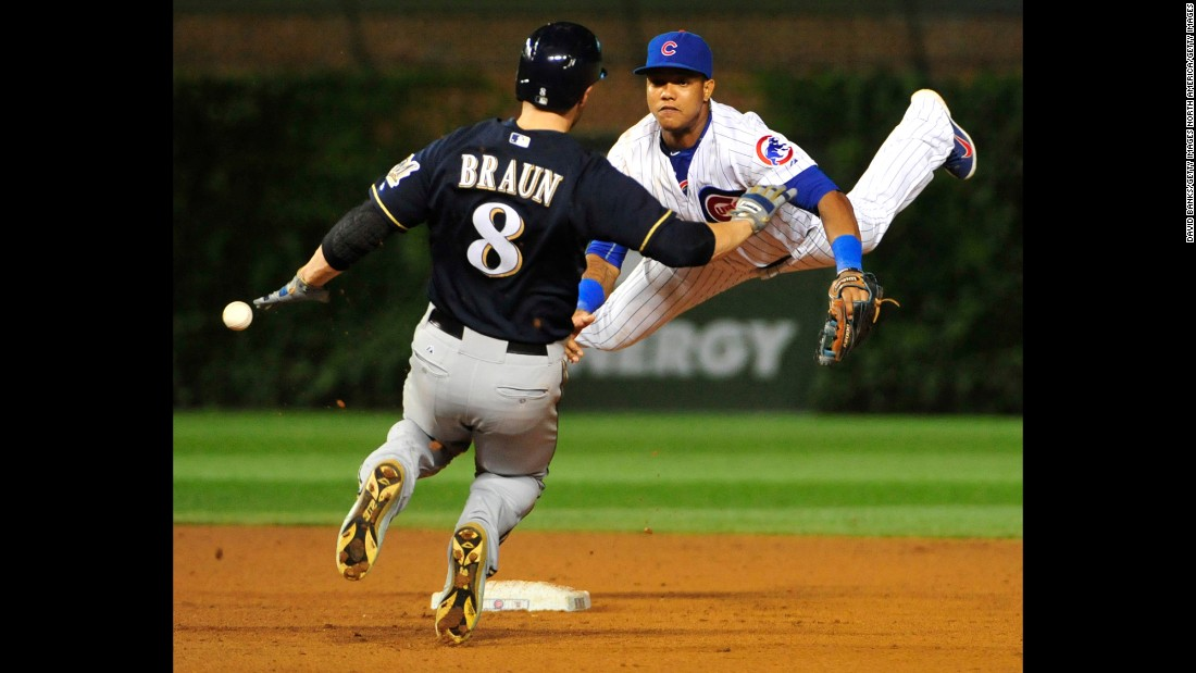 "Milwaukee's Ryan Braun slides safely into second as the ball goes by Starlin Castro of the Chicago Cubs on Wednesday, August 12. <a href=""http://www.cnn.com/2015/08/11/sport/gallery/what-a-shot-sports-0810/index.html"" target=""_blank"">See 26 amazing sports photos from last week</a>"