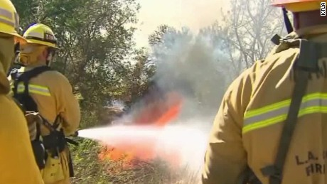 25,000 firefighters battle fire in 10 states