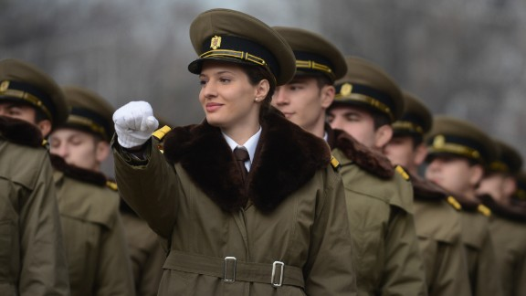 Romanian soldiers march in 2012. The country has sent nearly 60 women to Iraq in combat roles.
