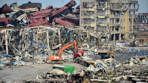 TIANJIN, CHINA - AUGUST 17: (CHINA OUT) Rescuers work at the blast site during the aftermath of the warehouse explosion on August 17, 2015 in Tianjin, China. The death toll has risen to 114 following last Wednesday night