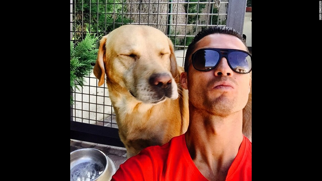 "Soccer star Cristiano Ronaldo <a href=""https://instagram.com/p/6R6zcfhpe1/"" target=""_blank"">snaps a selfie with his dog Marosca</a> on Wednesday, August 12."