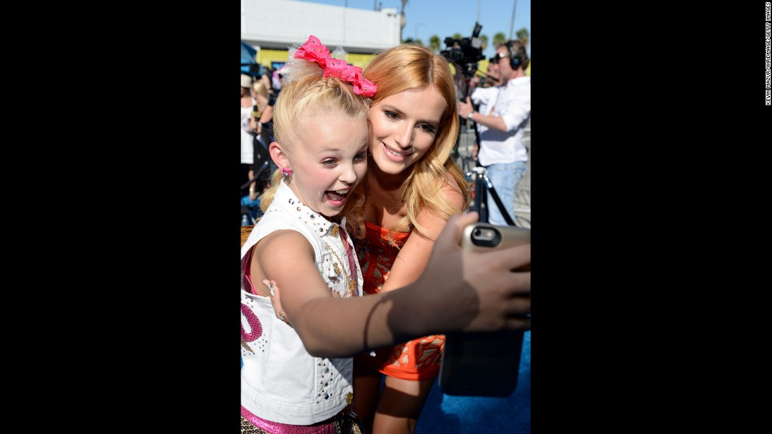 Actress Bella Thorne poses with a young fan while attending the Teen Choice Awards in Los Angeles on Sunday, August 16.