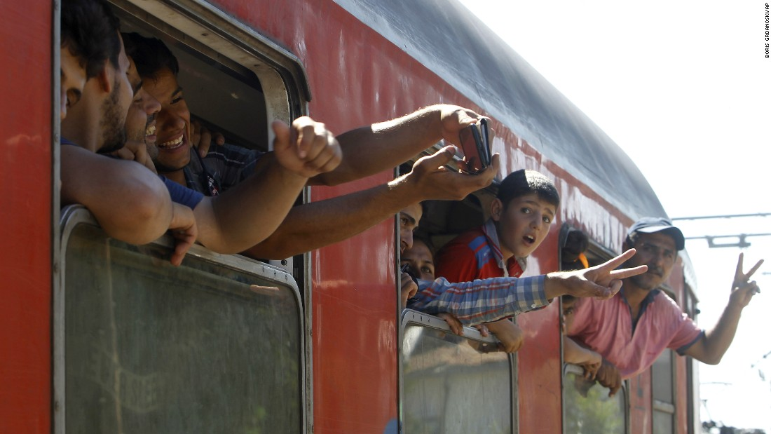 Migrants bound for Serbia take a selfie in the southern Macedonian town of Gevgelija on Monday, August 17.