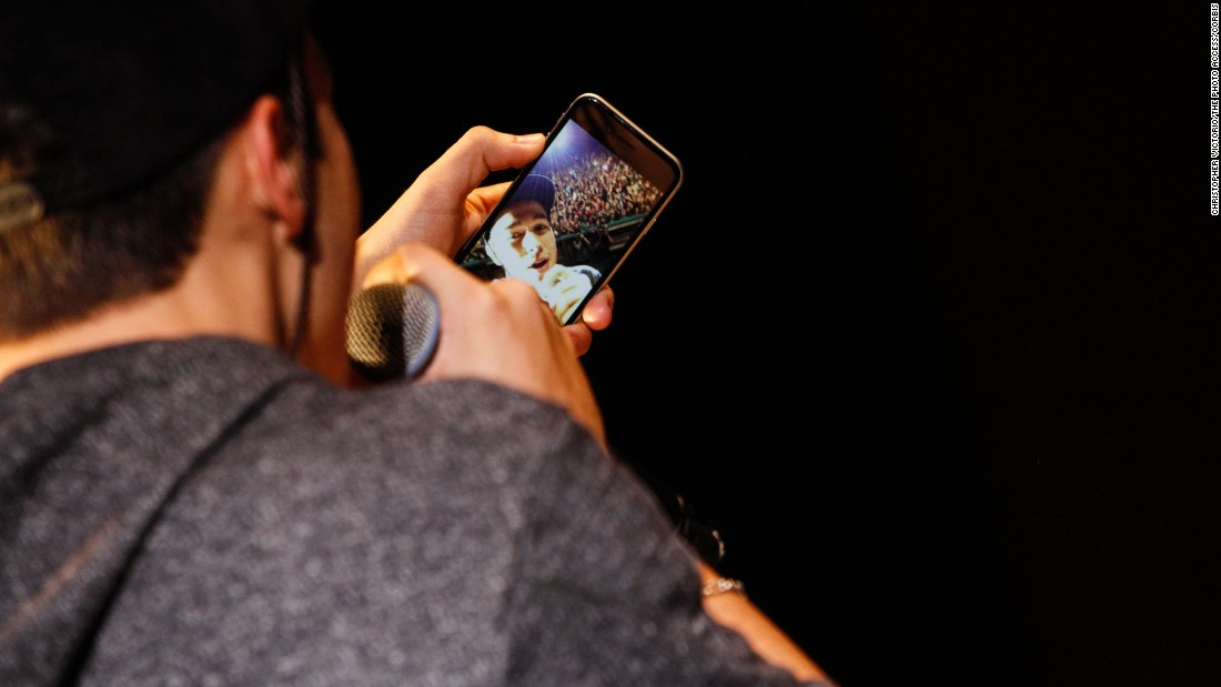 Singer Austin Mahone takes a selfie on his phone while performing at an event in Santa Clara, California, on Thursday, August 13.