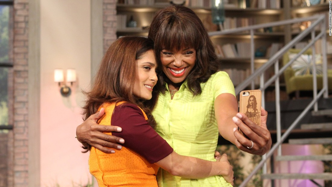 "Actress Salma Hayek hugs host Aisha Tyler as Tyler takes a selfie of the two on ""The Talk"" on Friday, August 14."