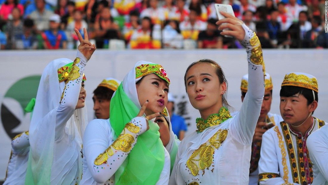 "Delegates from northwest China's Ningxia region take a selfie Monday, August 17, during the closing ceremony of the National Traditional Games of Ethnic Minorities of China. <a href=""http://www.cnn.com/2015/08/12/living/gallery/selfies-look-at-me-0811/index.html"" target=""_blank"">See 26 selfies from last week</a>"