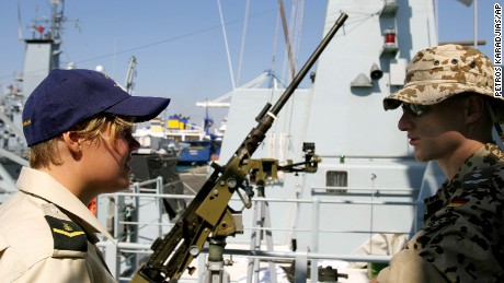 A female member of the Danish navy talks with a German soldier at a port in Cyprus in 2006.