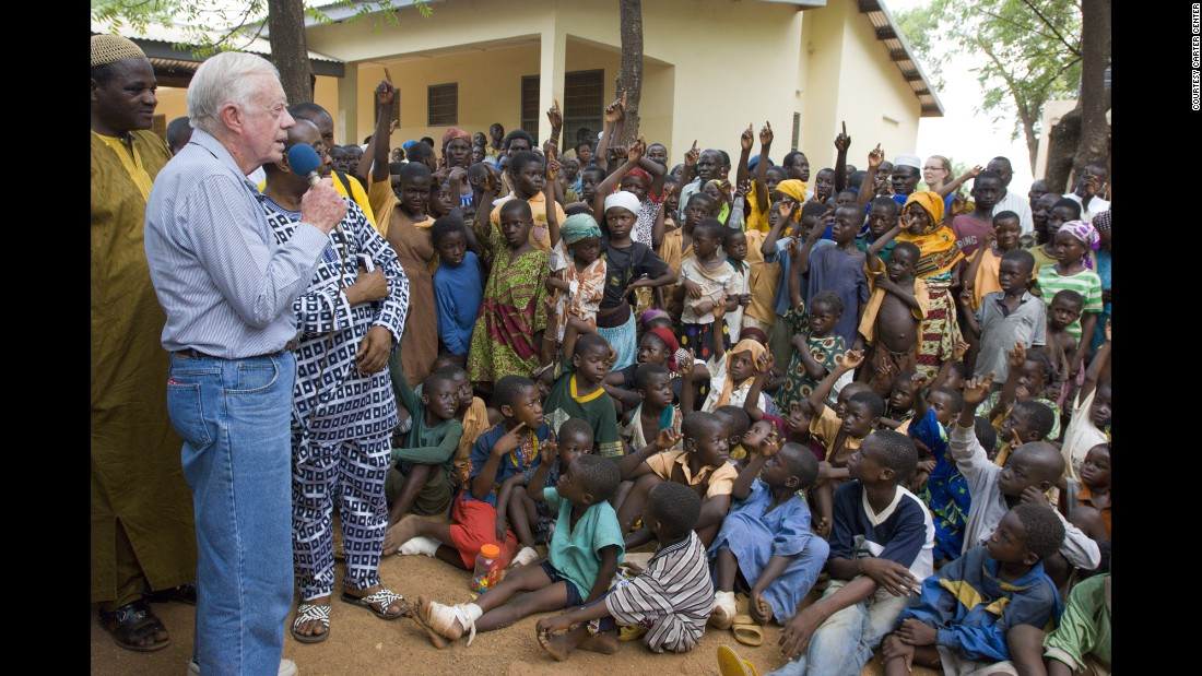 In February 2007, Carter speaks to children in Ghana on the seriousness of eradicating guinea worm disease.