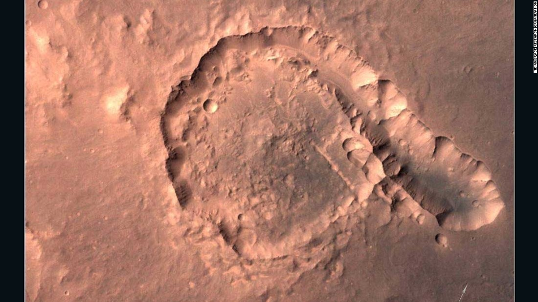 An image taken by the Mars Color Camera on April 23, 2015 shows the Pital Crater. Both the crater's wall and a chain of small impact craters are visible in the photo.