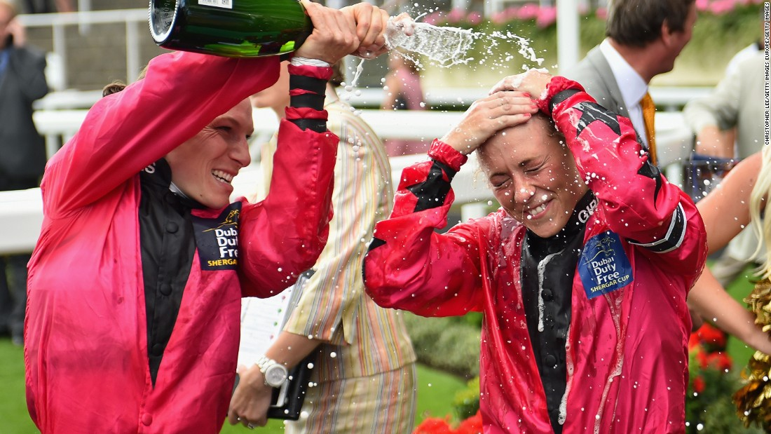 Captain of the Girls Team Emma-Jayne Wilson showers Bell with champagne after the apprentice helped seal the first-ever win for a female team in the annual competition.