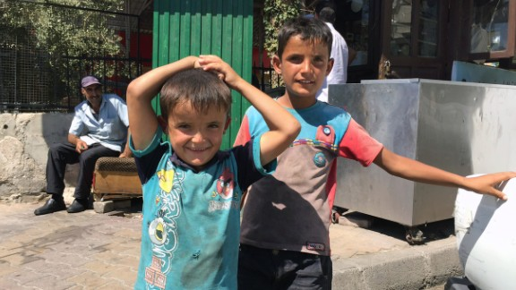 Ali, 5, and his brother Alla, 9, fled with their family to Damascus when their home in Idlib was destroyed by fighting. People in the capital are trying to maintain some sense of normalcy despite the ongoing war.