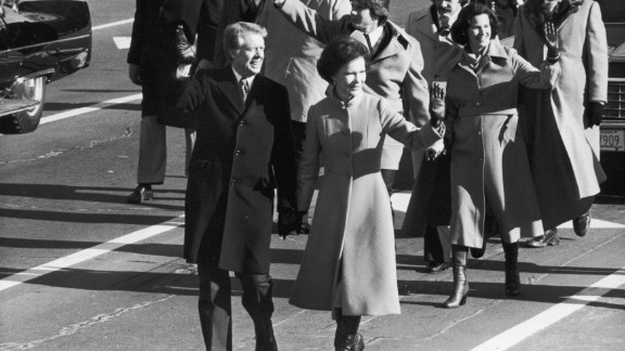 Carter holds his wife's hand during the inaugural parade.