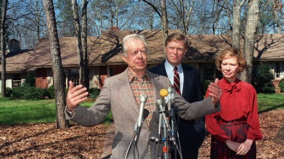 Carter addresses the media outside his residence in Plains, Georgia, next to his wife and Democratic presidential hopeful Richard Gephardt in March 1988.
