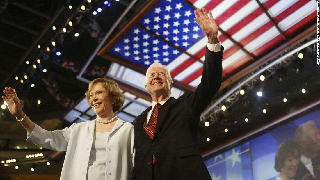 The Carters wave to the audience during the Democratic National Convention in July 2004.