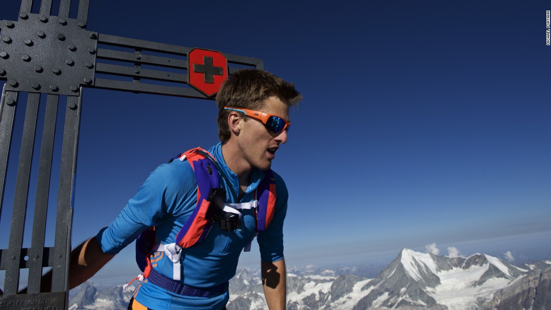 Andreas Steindl looks down from the top of one of the five peaks he crossed.