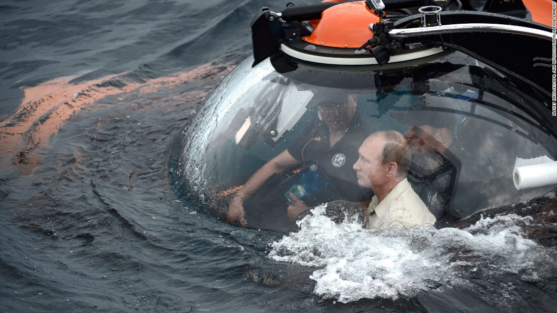 "Russian President <a href=""http://www.cnn.com/2012/03/02/europe/gallery/cult-of-vladimir-putin/index.html"" target=""_blank"">Vladimir Putin</a> sits in a bathyscaphe as it plunges into the Black Sea along the coast of Sevastopol, Crimea, on Tuesday, August 18. Putin plunged into the sea to see the wreckage of an ancient merchant ship that was found in the end of May."