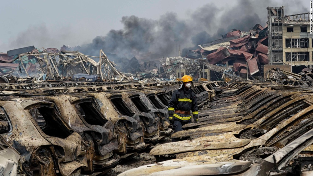 "A firefighter works Friday, August 14, in Tianjin, China, where <a href=""http://www.cnn.com/2015/08/20/asia/china-tianjin-explosions/"" target=""_blank"">a series of huge explosions</a> killed at least 114 people, according to officials and state media. The August 12 blasts occurred at a warehouse where more than 700 tons of highly toxic substances, mainly sodium cyanide, were being stored, state media reported. High levels of dangerous chemicals remain at the site."