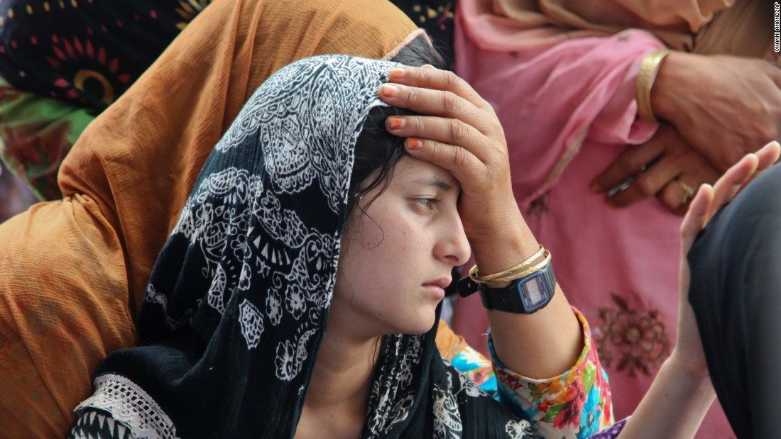 The daughter of Indian civilian Sarpanch Karamat Hussain mourns his death in Poonch, India, on Sunday, August 16. He was killed in shelling as Indian and Pakistani troops traded heavy gunfire and mortar rounds along the highly militarized line that divides Kashmir.