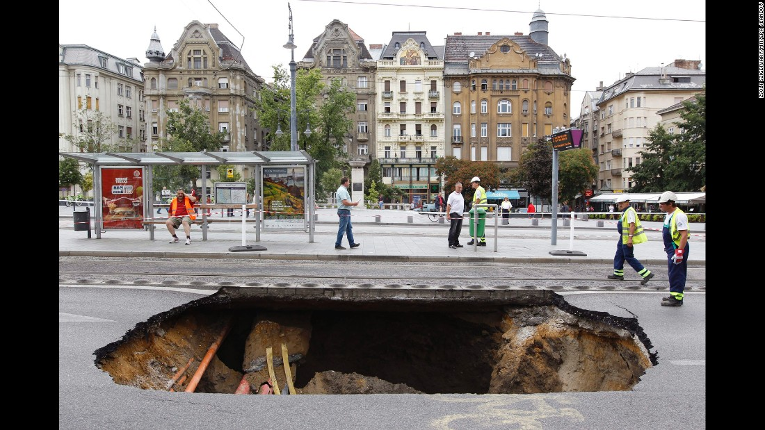 A sinkhole is seen in Budapest, Hungary, a day after a heavy storm on Monday, August 17.