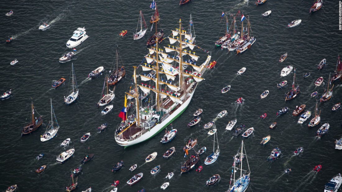 The ARC Gloria, the flagship of the Colombian Navy, is escorted by small boats as it arrives for a sailing festival in Amsterdam, Netherlands, on Wednesday, August 19.