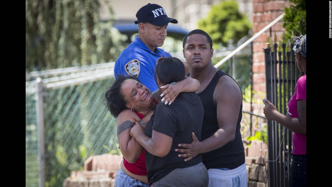 "People react to a sudden volley of gunfire near the scene where a man barricaded himself in his home after shooting a New York City Fire Department lieutenant on Friday, August 14. The man, identified as 38-year-old Garland Tyree, <a href=""http://www.nydailynews.com/new-york/nyc-crime/s-firefighter-shot-man-wanted-u-s-marshals-article-1.2325596"" target=""_blank"">was killed after a six-hour standoff with police,</a> officials said."