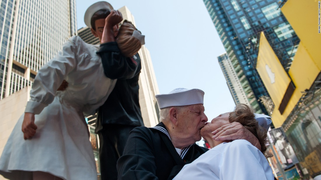 "World War II veterans Ray and Ellie Williams re-enact <a href=""http://www.cnn.com/2015/08/14/us/vj-day-kissing-sailor/"" target=""_blank"">the famous V-J Day kiss</a> Friday, August 14, in New York's Times Square. Hundreds of other couples also recreated the photo that was taken by Life magazine's Alfred Eisenstaedt 70 years ago."