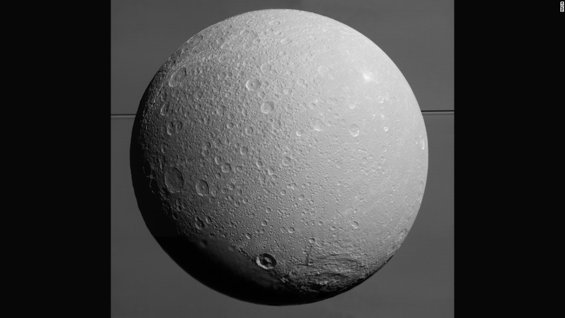 "Saturn's icy moon Dione, with giant Saturn and its rings in the background, was captured in this mosaic of images just prior the <a href=""http://saturn.jpl.nasa.gov/"" target=""_blank"">Cassini spacecraft's</a> final close approach to the moon on August 17, 2015. Scientists combined nine visible light images to create the mosaic. Cassini was at distances ranging from approximately 106,000 miles (170,000 kilometers) to 39,000 miles (63,000 kilometers) from Dione when the images were taken."
