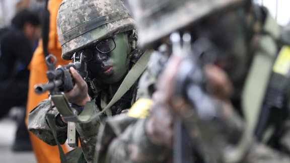 South Korean army soldiers aim their weapons during an anti-terror drill2 as part of Ulchi Freedom Guardian exercise, at Sadang Subway Station in Seoul, South Korea, Wednesday, Aug. 19, 2015. U.S. and South Korean forces launched Monday an annual joint military exercises, Ulchi Freedom Guardian, for a 12-day run to prepare for a possible North Korea's attack. (AP Photo/Ahn Young-joon)