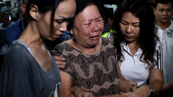 Family members of Neoh Hock Guan ,a Malaysian survivor of the Bangkok bomb blast, break down as they pay their last respects. Five out of the seven Neoh family members traveling to Bangkok together were killed in the blast.