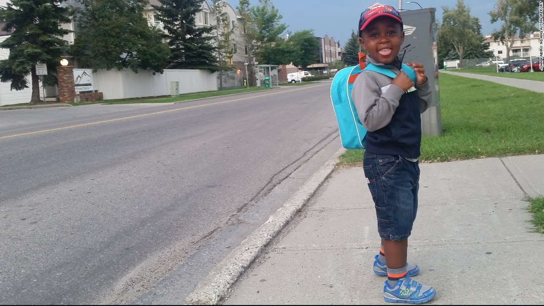 Preston, age 3, waits for the bus in Calgary, Alberta, wearing a backpack that holds his favorite Spider-Man toy, a school diary, banana, packet of apple juice and his snack box.