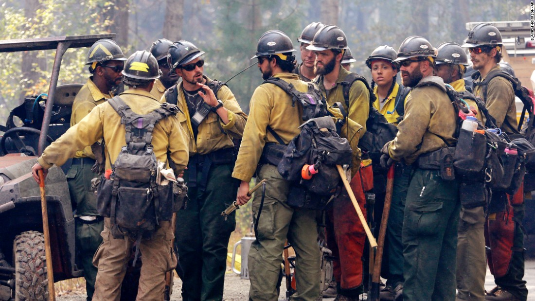 A crew leader talks to his firefighters about their plans to attack a fire burning in Twisp on August 20.